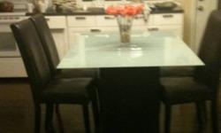 Glass top dining room table. 40 x60 inches with 4 brown leather chair. $300.00 This ad was posted with the Kijiji Classifieds app.