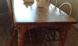 """Harvest Table. Solid Pine Table 84"""" X 41 1/2"""" 30 1/2"""" h. Table top 1 3/4"""" thick Legs 5"""" diam. @ top - 3"""" 1/2 """" diam. @ base 6 Oak Chairs seat 16"""" high, 3/8"""" thick, 6 spindle, back 37 1/2"""" high from floor to top , rail 1"""" wide. Sturdy, """" turned"""" legs."""