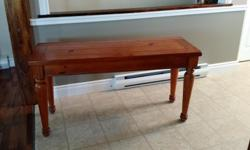 in excellent condition, this taller table is made from real wood with a country look and more or less a maple coloring, fits a country style theme or décor. 27' high, 52' long, 18' deep