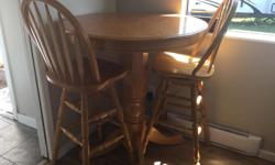"""Excellent condition oak Table and 4 matching bar stools Table is 36"""" round and 40"""" tall Stools are 29"""" Perfect for small eat in kitchen or outside covered deck Stools swivel Must see $275.00"""