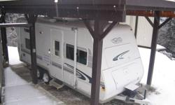 """2000 model 7213 Trail Lite . 21'6"""" in better than average condtion . Has four new tires , two new batteries , and new wastegate valves. Roof air , awning , three burner stove with oven , microwave oven , 6 cu ft 2 way frig ,ducted furnace. Light weight"""