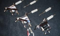 Three Tattoo Machines and more - The picture doesn?t properly show the shiny chrome on these machines. They have had little use so are still very good machines. The transformer and foot pedal are included. In the package I?m selling you would get some