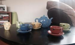 Little girls tea sets. Both for $10. They are complete sets one has side plates.