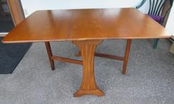 """Teak GPlan folding table in good condition. 36"""" wide and 54"""" long with both leaves up."""