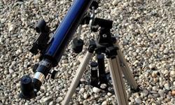 Tasco Galaxsee telescope 46-060675.  Excellent shape, amateur telescope.  See description below. * Telescope Type: Refractor * Objective Lens Diameter: 60mm * Focal Length: 900mm * Focal Ratio: 15 * Mount: Equatorial 1 * Barlow: 3X * Interchangeable