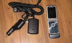 Telus Motorola Razr silver Phone is a couple years old but works great, no contract. Phone comes with car and home charger. $50 Please email if interested.