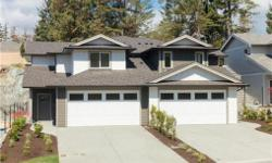 # Bath 3 Sq Ft 1593 # Bed 3 Custom built new duplex home, open concept design, loads of natural sunlight and large double garage. Main level offers wide plank laminate floors and cozy gas fireplace. The large, bright kitchen will delight any chef with its