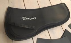 Thinline 'Ultra Thin' Trifecta Cotton Half Pad. Comes with full set of shims and extra set of rear riser shims. Just like this one: http://greenhawk.com/wdItemDesc.asp?strilhID=Web&strmdNumber=RIE5217&stricSKU=RIE5217 Sells for $220 new. Asking $120.