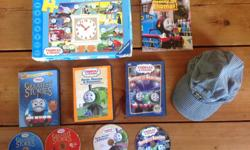 3 DVD's, 1 book, 1 puzzle with moving clock hands (no missing pieces) & Oshkosh engineers hat ( size 4-7).