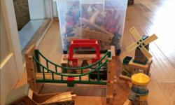 A whole box of Thomas the Train and friends - train figurines. bridges, water tower, mill, original tracks as well as compatible Melissa and Doug's), track risers, etc. Worth hundreds of dollars! Non-smoking, no pets house. Very good condition.