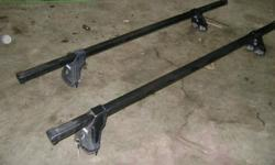 Thule Tracker roof Rack in good condition .P/N 515-5031 Came off of a Grand Cherokee.Designed to fit Factory installed T- racks on SUV's P/U's and cars. Comes with 2 keys . Locks are not seized . Located in Salmon Arm 250-833-04nine nine