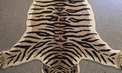 Fake tiger skin carpet.