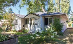 # Bath 1 Sq Ft 1113 MLS 368412 # Bed 3 WOW. Fantastic 3 bdrm bungalow resting on a magnificent 170' garden. Privacy, mature plantings and lots of potential! Level, this offering also possesses a separate garage/workshop. Main residence features: hardwood