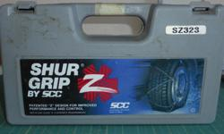 Suregrip tire chains. SZ 323 never been used. *Does not fit our present car wheels