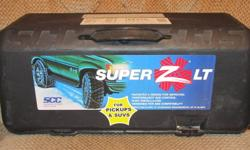 Super Z LT cable tire chains, never used, bought one year ago for vehicle that has now been sold.  Please note the picture with tire sizes that they will fit.