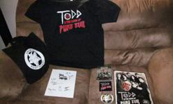 2 DVD (  Todd and the Book of  Pure Evil, season one, never opened.  And a new t- shirt, and a  holder bag, 2 big  emblems and a big poster of them all, all autograghed by each personAnd also the book, also autograghed by all of the cast..  All a big pkg.