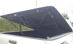 """""""Undercover"""" hard shell tonneau cover. Black, in great shape, lockable with key, lightweight, weather tight, strong and durable. 76in long 63in wide. Simple installation. It is currently on a 07 Toyota Tacoma short box"""