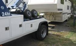 Do you have a goose neck or a fifth wheel trailer that you need moved give Phil's towing a call and we can help you move it .