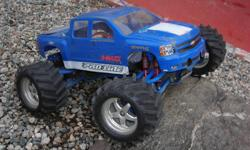 E-MAXX traxxas 1/10 scale. You can purchase one of two ways, with two brushed motor set up with new motors and new evx2 speed control and new servo. Or with a Velineon vxl-3 brushless motor set up which ever way you like. Brushed motor set up =$350.00  OR