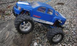 Traxxas e maxx Velineon brushless motor set up , lot's of RPM upgrades. Body alittle rough but still works , 27 mhz radio , you will need battery's and a charger and your set to go $450.00