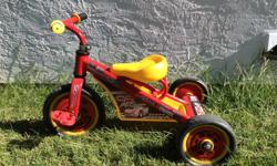 Cars theme tricycle with foam wheels. Good condition.