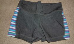 Grey triple flip shorts, size 5, purple, pink, blue, and white design down the sides, $12
