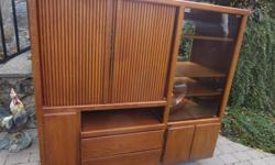 """A really nice piece of furniture!! Lots of storage!!! Glass door on one side. Large space for TV (opening is 32""""). Five drawers at the bottom. Great condition. We can help load if you come this weekend. Bear Mountain area of Langford. Please call"""