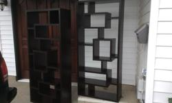 two backless cube shelving units, not too sure if they are wooden but for sure the veneer is not wood, I would call it a dark cherry finish, they do have some scratches, mostly on the sides but other than that they are in very good condition and can be
