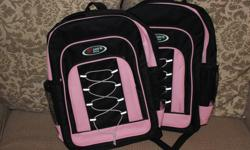 """Two brand NEW matching children's backpacks. Never used. Perfect condition. King's Style Brand. Three zippered pockets. Mesh pouches on both sides. Adjustable straps. The backpacks are approximately 16"""" high, 11.5"""" wide at the base (10"""" wide at the top)"""