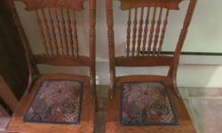 two dining room ,oak chairs with padded seat,