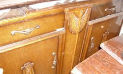 Unique vintage buffet in as found condition.  Two drawers and two doors.  Mirrored back.  A little TLC will give you a piece of furniture that will bring a lot of compliments and last for years.  4 feet x 6 inches wide, 18 1/2 inches deep, and 3 feet in