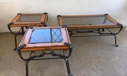 Glass top coffee table with 2 matching end tables. Very sturdy. Western style metal work looks like leather.