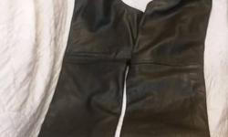 Unisex Pro Rider Leather Chaps - Used only a half dozen times at most. ~ Size 4x ~ Made of Topgrain Cowhide Leather ~ Inside Mesh lining ~ Two side deep pockets ~ Snap button bottom closure, ~ Zipper side entry and a 31 Inch Inseam. ~ Elastic gusset at