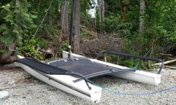 Older Hobie 17. Not suitable for racing but still makes a fun recreational sailing catamaran. Hulls, tramp, wings, EPO rudders, Harken blocks, and mast are all in good shape. No tears in sail but will likely need replacing in a year or two. No trailer but