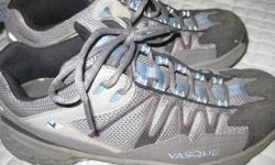 This is a almost brand new pair of Vasque Trail Runners, I have worn them maybe two to three times but they were too tight on my toes.  They are grey with blue.  Retail for over $100