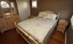 This 7 piece bedroom set is in great condition and includes: Headboard Footboard Dresser Mirror Night Stand Armoire (not pictured) Hope Chest We are also including the queen size mattress and box spring for FREE!