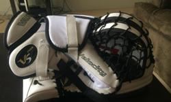 Perfect condition, never been used Vaughn V5 goaltenders glove. Colours are White, Red and Black.