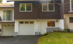 # Bath 1 Sq Ft 1424 MLS 401711 # Bed 2 Set up & away from the road, this 3 level adult 40+ Townhome is neat as a pin & ready to move in. Features include vinyl windows, newer roof, oak flooring on the main floor, stunning updated bathroom with soaker tub.
