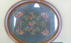Antique/Circa - 1893 Homemade Needlepoint framed and in glass.   The frame is wood.  I bought the piece as is at an auction in San Francisco, California.  It has been in my home for years.  We are downsizing our collectables.   It is in Excellent