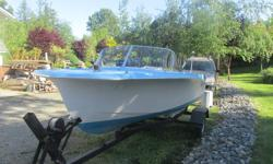 Rare Vintage 1950's Rinell Sport craft boat, with 1963 35 h.p Viking motor , robins egg blue , fins with a classic hot rod style , trailer complete ready to go. $1800.00 obo