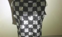 Gorgeous vintage top with black and silver sequins ina checkered patern. Cute rolled over neckline and zipper running down the back. Lined in black satin. Size smalll to medium
