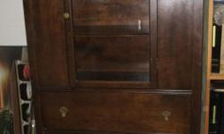 Approximately 5 feet tall, 15 inches deep & 3 feet long/wide. This buffet has it's original finish. It is a dark finish although the flash from the camera makes it appear lighter. It has some scratches and marks as it has been a cabinet used for many