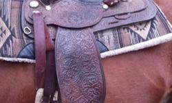 16 inch seat, great shape, dark leather with matching bridle also.