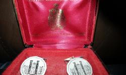 3 pairs of men's cuff links, 1 pair silver tone and mother of pearl; 1 pair gold tone with red stones; 1 pair collectable Canadian Mint (Ottawa) in original case. All in good condition.