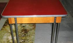 """A little different than the normal """"50's"""" table, this one has a formica top, chrome edging, wood sides and chrome legs which are also a different shape than what you normally see on these vintage tables. The table measures 42"""" x 30"""" prior to the leaf"""