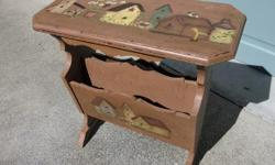 """Vintage magazine stand. Painted chocolate brown with hand painted scenes on each side. Still solid with some wear over the years. Measures 24"""" X 11 1/2"""" X 25' tall. Call or text, and if you email please leave name and phone number."""