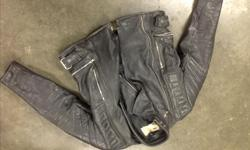 Ren leathers from New York. Vintage riding jacket Size 38/40? Stretch sides with padded elbows,upper arm and shoulders Leather is good condition