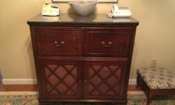 Converted to a Liquor Cabinet. Circa maybe the 40's. Still has the original fabric lining the bottom doors! Glass top fits perfectly and is in great shape. Text for faster response, wifi is cutting out at times. 1-250-897-8226