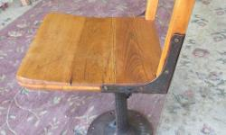 """Early 1900's, child's oak school chair. Adjustable height. Nice industrial iron base ( could be re-purposed as stand for table, etc.). Base is 9 1/2"""" diameter. Call or text, and if you email please leave name and phone number."""