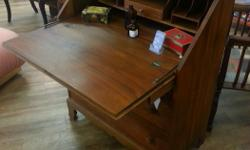 """Beautiful and solid vintage secretary desk with walnut finish. In excellent condition. Measures: 34"""" wide x 18"""" deep x 40.5"""" high The Old Attic Vintage ~ Antiques Retro ~ Modern Old ~ New Open Daily, 10am - 5pm 7925 E. Saanich Rd. 778-426-1660 EMAIL:"""